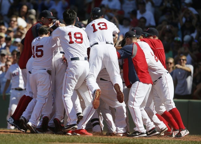 Jun 18, 2014; Boston, MA, USA; The Boston Red Sox greet first baseman Mike Napoli (12) at home plate after hitting the game winning home run against the Minnesota Twins in the tenth inning at Fenway Park. The Red Sox defeated the Twins 2-1. Mandatory Credit: David Butler II-USA TODAY Sports