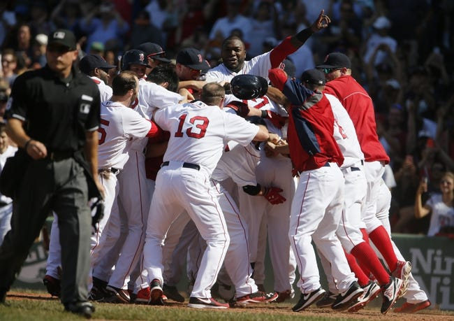 Jun 18, 2014; Boston, MA, USA; The Boston Red Sox celebrate with first baseman Mike Napoli (12) at home plate after hitting the game winning home run against the Minnesota Twins in the tenth inning at Fenway Park. The Red Sox defeated the Twins 2-1. Mandatory Credit: David Butler II-USA TODAY Sports