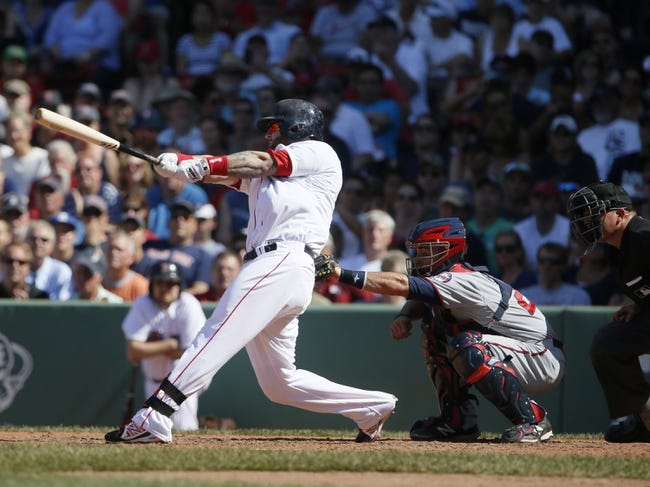 Jun 18, 2014; Boston, MA, USA; Boston Red Sox first baseman Mike Napoli (12) hits the game winning home run against the Minnesota Twins in the tenth inning at Fenway Park. The Red Sox defeated the Twins 2-1. Mandatory Credit: David Butler II-USA TODAY Sports