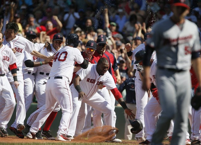Jun 18, 2014; Boston, MA, USA; Boston Red Sox designated hitter David Ortiz (34) and teammates make way for first baseman Mike Napoli (12) (not pictured) at home plate after hitting the game winning home run against the Minnesota Twins in the tenth inning at Fenway Park. The Red Sox defeated the Twins 2-1. Mandatory Credit: David Butler II-USA TODAY Sports