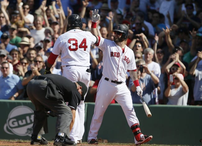 Jun 18, 2014; Boston, MA, USA; Boston Red Sox designated hitter David Ortiz (34) is congratulated by first baseman Mike Napoli (12) after hitting a home run against the Minnesota Twins in the tenth inning at Fenway Park. The Red Sox defeated the Twins 2-1. Mandatory Credit: David Butler II-USA TODAY Sports