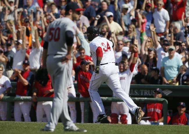 Jun 18, 2014; Boston, MA, USA; Boston Red Sox designated hitter David Ortiz (34) rounds the bases after hitting a home run against Minnesota Twins relief pitcher Casey Fien (50) in the tenth inning at Fenway Park. The Red Sox defeated the Twins 2-1. Mandatory Credit: David Butler II-USA TODAY Sports
