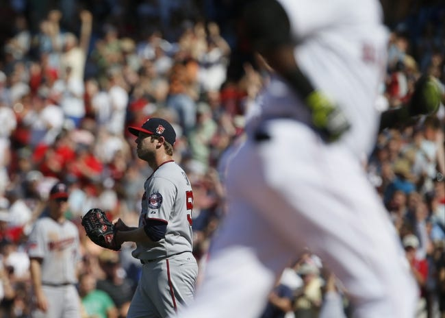 Jun 18, 2014; Boston, MA, USA; Minnesota Twins relief pitcher Casey Fien (50) reacts after Boston Red Sox designated hitter David Ortiz (34) hit a home run in the tenth inning at Fenway Park. The Red Sox defeated the Twins 2-1. Mandatory Credit: David Butler II-USA TODAY Sports