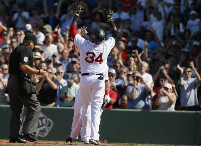 Jun 18, 2014; Boston, MA, USA; Boston Red Sox designated hitter David Ortiz (34) reacts after hitting a home run against the Minnesota Twins in the tenth inning at Fenway Park. The Red Sox defeated the Twins 2-1. Mandatory Credit: David Butler II-USA TODAY Sports