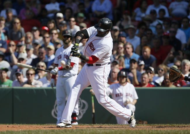 Jun 18, 2014; Boston, MA, USA; Boston Red Sox designated hitter David Ortiz (34) hits a home run against the Minnesota Twins in the tenth inning at Fenway Park. The Red Sox defeated the Twins 2-1. Mandatory Credit: David Butler II-USA TODAY Sports