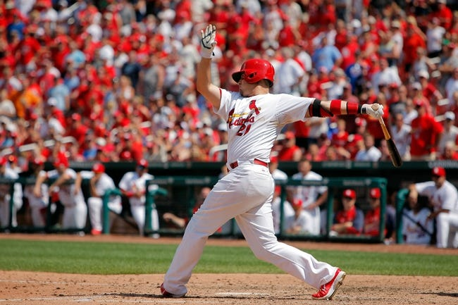 Jun 18, 2014; St. Louis, MO, USA; St. Louis Cardinals right fielder Allen Craig (21) hits for a RBI single during the ninth inning against the New York Mets at Busch Stadium. The Mets won 3-2. Mandatory Credit: Scott Kane-USA TODAY Sports