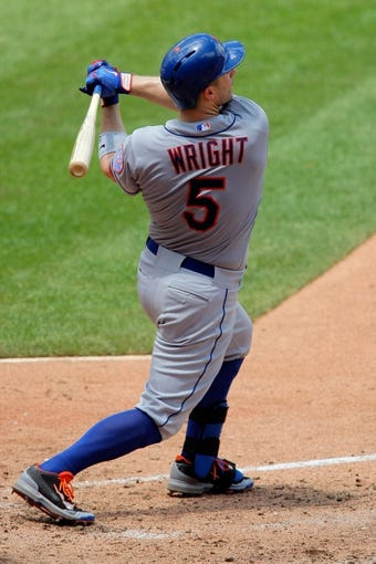Jun 18, 2014; St. Louis, MO, USA; New York Mets third baseman David Wright (5) hits for a RBI single during the sixth inning against the St. Louis Cardinals at Busch Stadium. The Mets won 3-2. Mandatory Credit: Scott Kane-USA TODAY Sports