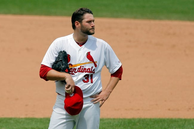 Jun 18, 2014; St. Louis, MO, USA; St. Louis Cardinals starting pitcher Lance Lynn (31) walks to the dugout at the end of the sixth inning against the New York Mets at Busch Stadium. The Mets won 3-2. Mandatory Credit: Scott Kane-USA TODAY Sports