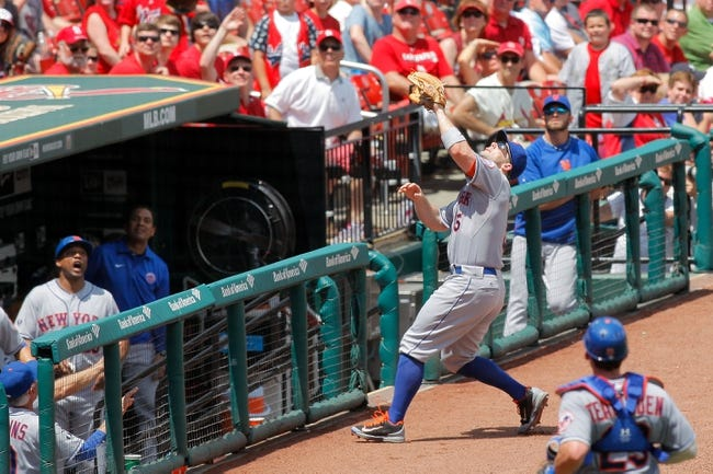 Jun 18, 2014; St. Louis, MO, USA; New York Mets third baseman David Wright (5) catches a foul ball off the bat of St. Louis Cardinals shortstop Daniel Descalso (33, not pictured) to end the fifth inning at Busch Stadium. The Mets won 3-2. Mandatory Credit: Scott Kane-USA TODAY Sports