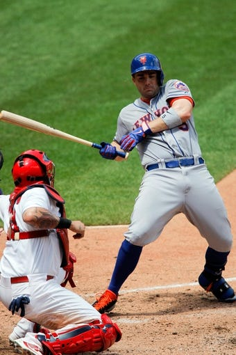 Jun 18, 2014; St. Louis, MO, USA; New York Mets third baseman David Wright (5) jumps back from an inside pitch during the sixth inning against the St. Louis Cardinals at Busch Stadium. The Mets won 3-2. Mandatory Credit: Scott Kane-USA TODAY Sports