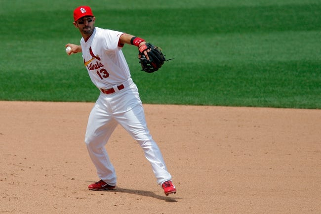 Jun 18, 2014; St. Louis, MO, USA; St. Louis Cardinals third baseman Matt Carpenter (13) makes a play during the sixth inning against the New York Mets at Busch Stadium. The Mets won 3-2. Mandatory Credit: Scott Kane-USA TODAY Sports