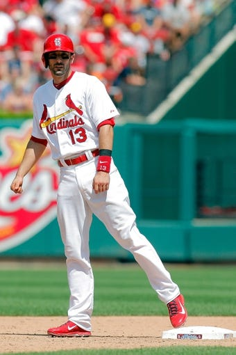 Jun 18, 2014; St. Louis, MO, USA; St. Louis Cardinals third baseman Matt Carpenter (13) stands on first after hitting a single during the ninth inning against the New York Mets at Busch Stadium. The Mets won 3-2. Mandatory Credit: Scott Kane-USA TODAY Sports