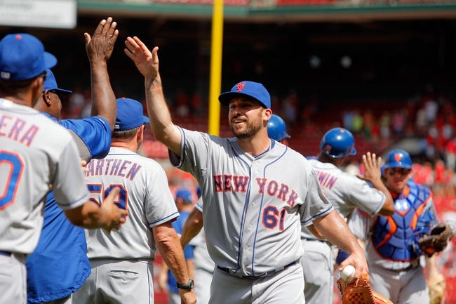 Jun 18, 2014; St. Louis, MO, USA; New York Mets relief pitcher Dana Eveland (61) celebrates with teammates after the Mets 3-2 victory against the St. Louis Cardinals at Busch Stadium. Mandatory Credit: Scott Kane-USA TODAY Sports