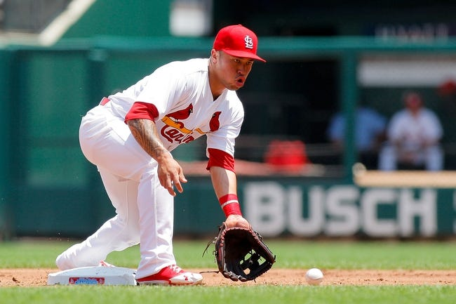 Jun 18, 2014; St. Louis, MO, USA; St. Louis Cardinals second baseman Kolten Wong (16) fields the ball to tag out New York Mets right fielder Curtis Granderson (not pictured) on a stolen base attempt during the second inning at Busch Stadium. The Mets won 3-2. Mandatory Credit: Scott Kane-USA TODAY Sports