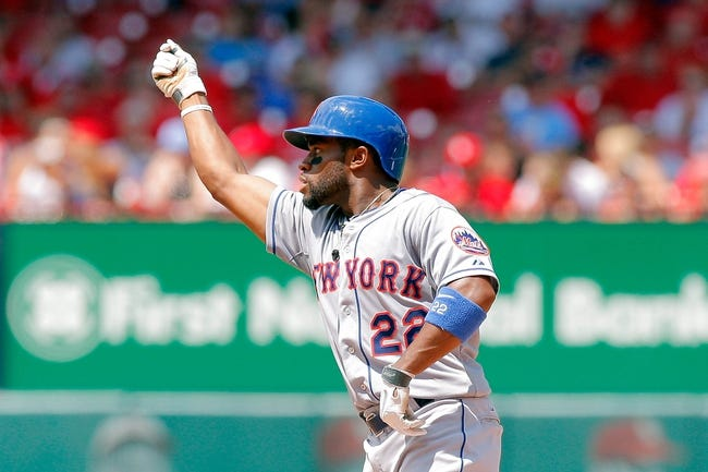 Jun 18, 2014; St. Louis, MO, USA; New York Mets left fielder Eric Young Jr. (22) celebrates on second after hitting a ground rule double during the seventh inning against the St. Louis Cardinals at Busch Stadium. The Mets won 3-2. Mandatory Credit: Scott Kane-USA TODAY Sports