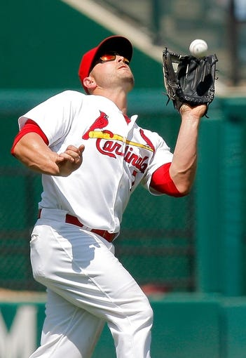 Jun 18, 2014; St. Louis, MO, USA; St. Louis Cardinals left fielder Matt Holliday (7) catches a fly ball hit by New York Mets right fielder Bobby Abreu (not pictured) during the ninth inning at Busch Stadium. The Mets won 3-2. Mandatory Credit: Scott Kane-USA TODAY Sports