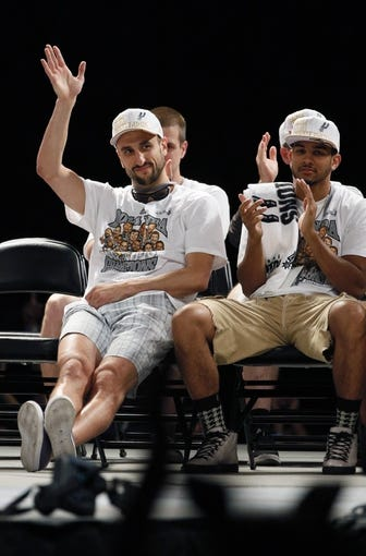 Jun 18, 2014; San Antonio, TX, USA; San Antonio Spurs guard Manu Ginobili (20) waves to the crowd during NBA championship celebrations at Alamodome. Mandatory Credit: Soobum Im-USA TODAY Sports