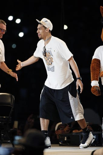 Jun 18, 2014; San Antonio, TX, USA; San Antonio Spurs guard Danny Green (4) is introduced during NBA championship celebrations at Alamodome. Mandatory Credit: Soobum Im-USA TODAY Sports