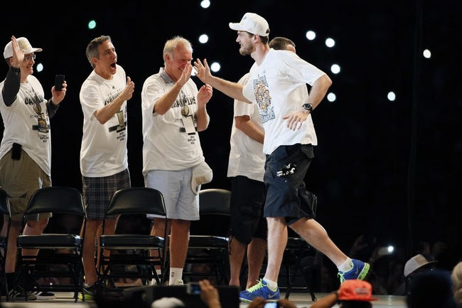 Jun 18, 2014; San Antonio, TX, USA; San Antonio Spurs forward Tiago Splitter (22) is introduced during NBA championship celebrations at Alamodome. Mandatory Credit: Soobum Im-USA TODAY Sports