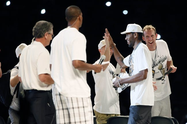 Jun 18, 2014; San Antonio, TX, USA; San Antonio Spurs forward Kawhi Leonard (second from right) is introduced during NBA championship celebrations at Alamodome. Mandatory Credit: Soobum Im-USA TODAY Sports