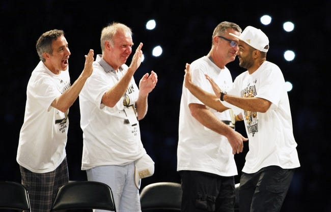 Jun 18, 2014; San Antonio, TX, USA; San Antonio Spurs guard Tony Parker (right) is introduced during NBA championship celebrations at Alamodome. Mandatory Credit: Soobum Im-USA TODAY Sports