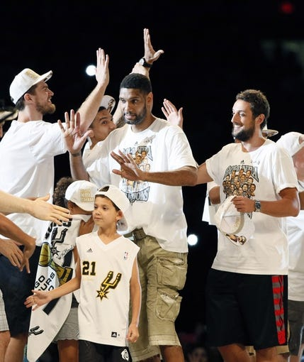 Jun 18, 2014; San Antonio, TX, USA; San Antonio Spurs forward Tim Duncan (21) is introduced during NBA championship celebrations at Alamodome. Mandatory Credit: Soobum Im-USA TODAY Sports