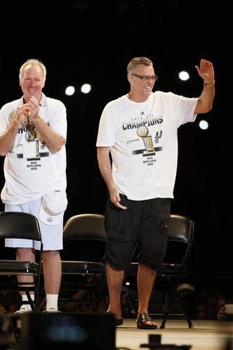 Jun 18, 2014; San Antonio, TX, USA; San Antonio Spurs general manager R.C. Buford waves to the crowd during NBA championship celebrations at Alamodome. Mandatory Credit: Soobum Im-USA TODAY Sports
