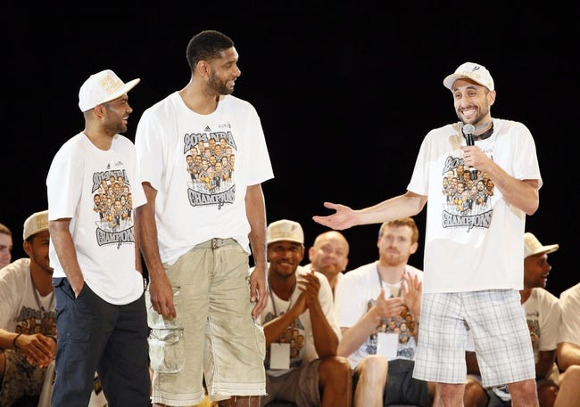 Jun 18, 2014; San Antonio, TX, USA; San Antonio Spurs guard Manu Ginobili (right) speaks as teammates Tony Parker (left) and Tim Duncan (center) listen during NBA championship celebrations at Alamodome. Mandatory Credit: Soobum Im-USA TODAY Sports