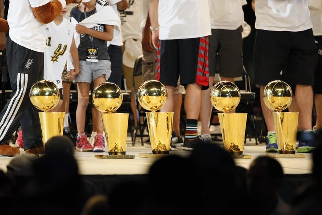 Jun 18, 2014; San Antonio, TX, USA; San Antonio Spurs championship trophies are displayed during NBA championship celebrations at Alamodome. Mandatory Credit: Soobum Im-USA TODAY Sports
