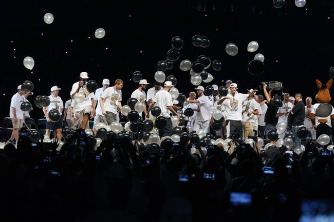 Jun 18, 2014; San Antonio, TX, USA; San Antonio Spurs players celebrate during NBA championship celebrations at Alamodome. Mandatory Credit: Soobum Im-USA TODAY Sports