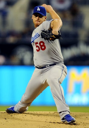 April 10, 2013; San Diego, CA, USA; Los Angeles Dodgers starting pitcher Chad Billingsley (58) throws during the first inning against the San Diego Padres at Petco Park.  Mandatory Credit: Christopher Hanewinckel-USA TODAY Sports