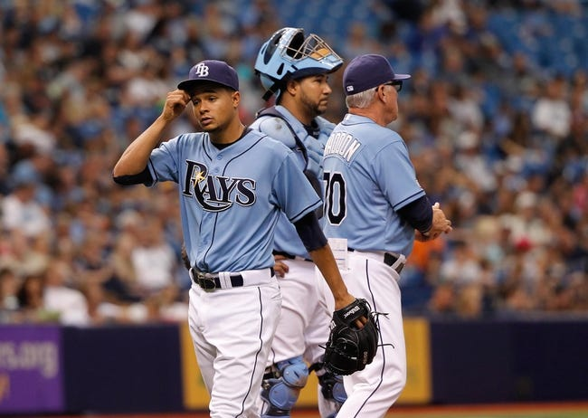 Jun 8, 2014; St. Petersburg, FL, USA; Tampa Bay Rays starting pitcher Chris Archer (22) is taken out of the game by manager Joe Maddon (70) against the Seattle Mariners at Tropicana Field. Mandatory Credit: Kim Klement-USA TODAY Sports