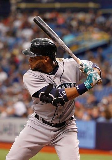 Jun 8, 2014; St. Petersburg, FL, USA; Seattle Mariners second baseman Robinson Cano (22) at bat against the Tampa Bay Rays at Tropicana Field. Mandatory Credit: Kim Klement-USA TODAY Sports