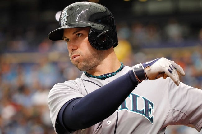 Jun 8, 2014; St. Petersburg, FL, USA; Seattle Mariners left fielder Cole Gillespie (16) on deck to bat against the Tampa Bay Rays at Tropicana Field. Mandatory Credit: Kim Klement-USA TODAY Sports