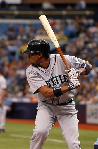 Jun 8, 2014; St. Petersburg, FL, USA; Seattle Mariners left fielder Endy Chavez (9) at bat against the Tampa Bay Rays at Tropicana Field. Mandatory Credit: Kim Klement-USA TODAY Sports