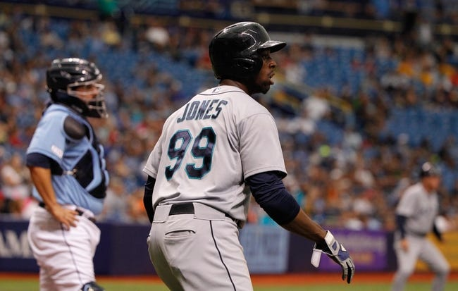 Jun 8, 2014; St. Petersburg, FL, USA; Seattle Mariners center fielder James Jones (99) scores a run against the Tampa Bay Rays at Tropicana Field. Seattle Mariners defeated the Tampa Bay Rays 5-0. Mandatory Credit: Kim Klement-USA TODAY Sports
