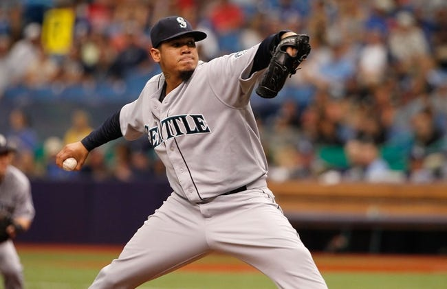 Jun 8, 2014; St. Petersburg, FL, USA; Seattle Mariners starting pitcher Felix Hernandez (34) throws a pitch during the first inning against the Tampa Bay Rays at Tropicana Field. Mandatory Credit: Kim Klement-USA TODAY Sports