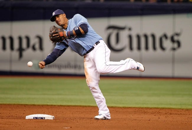 Jun 8, 2014; St. Petersburg, FL, USA; Tampa Bay Rays shortstop Yunel Escobar (11) throws the ball to first against the Seattle Mariners at Tropicana Field. Mandatory Credit: Kim Klement-USA TODAY Sports