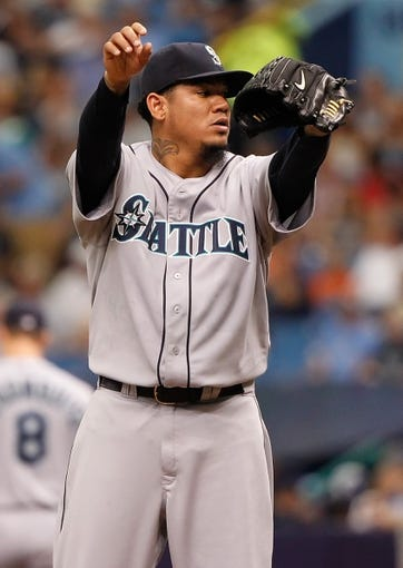 Jun 8, 2014; St. Petersburg, FL, USA; Seattle Mariners starting pitcher Felix Hernandez (34) on the mound against the Tampa Bay Rays at Tropicana Field. Mandatory Credit: Kim Klement-USA TODAY Sports