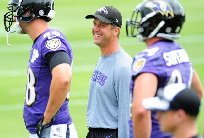 Jun 19, 2014; Baltimore, MD, USA; Baltimore Ravens head coach John Harbaugh (center) talks to tight end Dennis Pitta (left) during minicamp at the Under Armour Performance Center. Mandatory Credit: Evan Habeeb-USA TODAY Sports