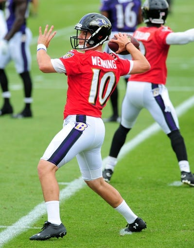 Jun 19, 2014; Baltimore, MD, USA; Baltimore Ravens quarterback Keith Wenning (10) throws a pass during minicamp at the Under Armour Performance Center. Mandatory Credit: Evan Habeeb-USA TODAY Sports