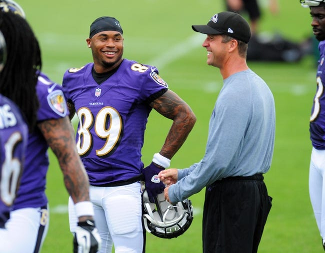 Jun 19, 2014; Baltimore, MD, USA; Baltimore Ravens wide receiver Steve Smith, Sr. (89) talks with head coach John Harbaugh (right) during minicamp at the Under Armour Performance Center. Mandatory Credit: Evan Habeeb-USA TODAY Sports