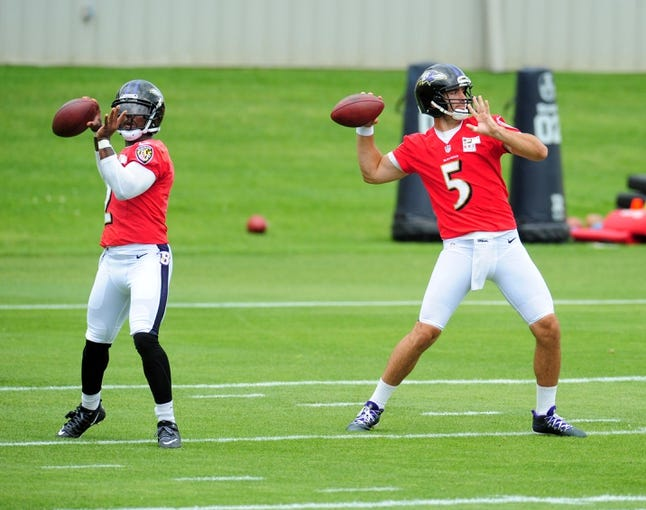 Jun 19, 2014; Baltimore, MD, USA; Baltimore Ravens quarterbacks Tyrod Taylor (left) and Joe Flacco (right) throw passes during minicamp at the Under Armour Performance Center. Mandatory Credit: Evan Habeeb-USA TODAY Sports