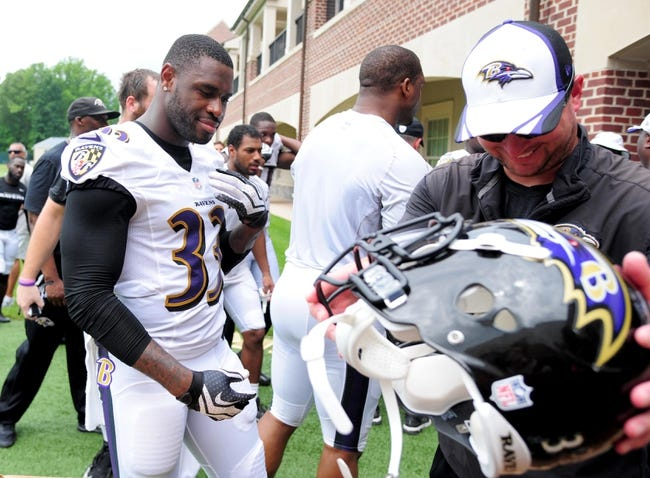 Jun 19, 2014; Baltimore, MD, USA; Baltimore Ravens safety Terrence Brooks (33) puts his helmet away after minicamp at the Under Armour Performance Center. Mandatory Credit: Evan Habeeb-USA TODAY Sports