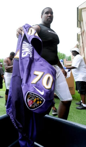 Jun 19, 2014; Baltimore, MD, USA; Baltimore Ravens offensive tackle David Mims (70) puts his jersey away after minicamp at the Under Armour Performance Center. Mandatory Credit: Evan Habeeb-USA TODAY Sports