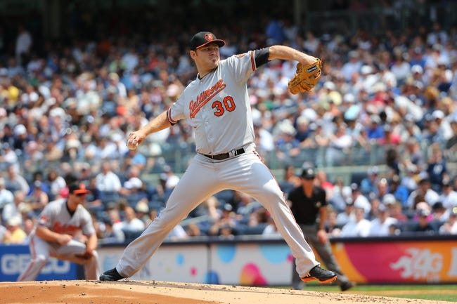 Jun 22, 2014; Bronx, NY, USA;  Baltimore Orioles starting pitcher Chris Tillman (30) pitches during the first inning against the New York Yankees at Yankee Stadium. Mandatory Credit: Anthony Gruppuso-USA TODAY Sports