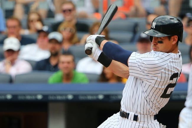 Jun 22, 2014; Bronx, NY, USA;  New York Yankees center fielder Jacoby Ellsbury (22) doubles to deep right during the fourth inning against the Baltimore Orioles at Yankee Stadium. Mandatory Credit: Anthony Gruppuso-USA TODAY Sports