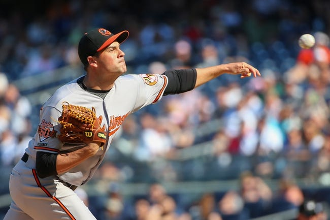 Jun 22, 2014; Bronx, NY, USA;  Baltimore Orioles relief pitcher T.J. McFarland (66) delivers a pitch during the eighth inning against the New York Yankees at Yankee Stadium. Baltimore Orioles won 8-0. Mandatory Credit: Anthony Gruppuso-USA TODAY Sports