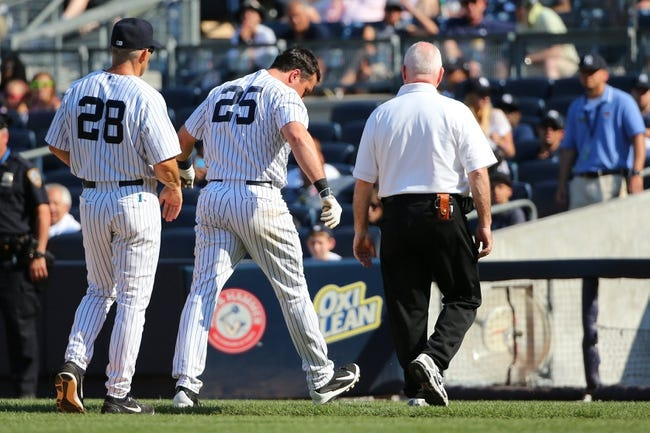 Jun 22, 2014; Bronx, NY, USA;  New York Yankees first baseman Mark Teixeira (25) leaves the field after being hit by a pitch during the eighth inning by Baltimore Orioles relief pitcher T.J. McFarland (66) (not shown) at Yankee Stadium. Baltimore Orioles won 8-0. Mandatory Credit: Anthony Gruppuso-USA TODAY Sports