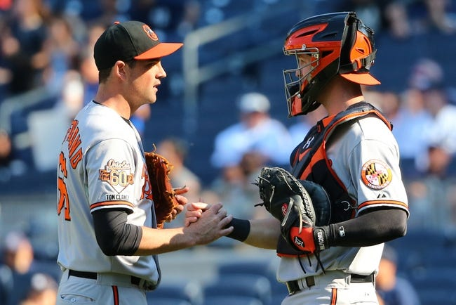 Jun 22, 2014; Bronx, NY, USA;  Baltimore Orioles relief pitcher T.J. McFarland (66) and catcher Caleb Joseph (36) celebrate the win against the New York Yankees at Yankee Stadium. Baltimore Orioles won 8-0. Mandatory Credit: Anthony Gruppuso-USA TODAY Sports